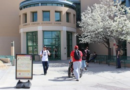 Students outside of Corbett Center express their daily student life.